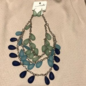 Layered necklace, earrings from Charming Charlie